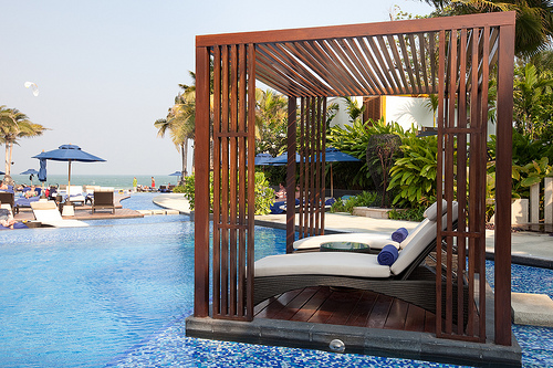 Lounge chairs are gently suspended over the pool, providing a stunning way to pass the day.