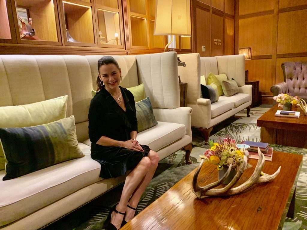Woman sitting on a couch at Emirates One & Only Wolgan Valley Resort