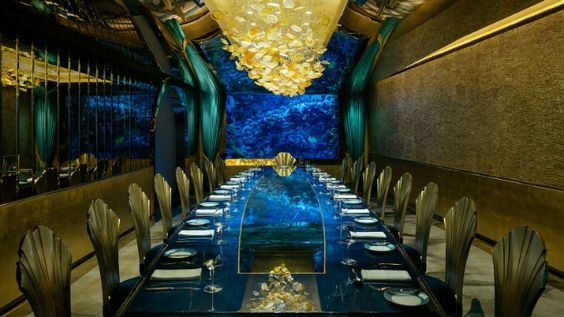 Exquisite dining table at Al Mahara Restaurant in Dubai. Image from Pinterest.