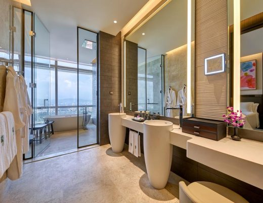 luxury bathroom in luxury hotel showing mirris, sinks and views.