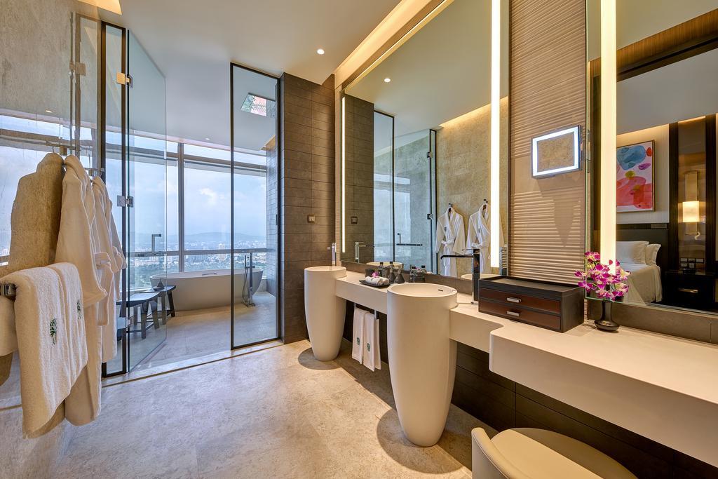 luxury bathroom in luxury hotel showing mirris, sinks and views.