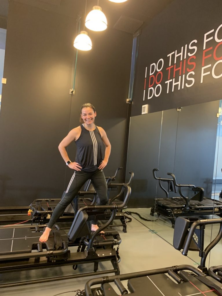 brunette woman on large fitness machine exercising