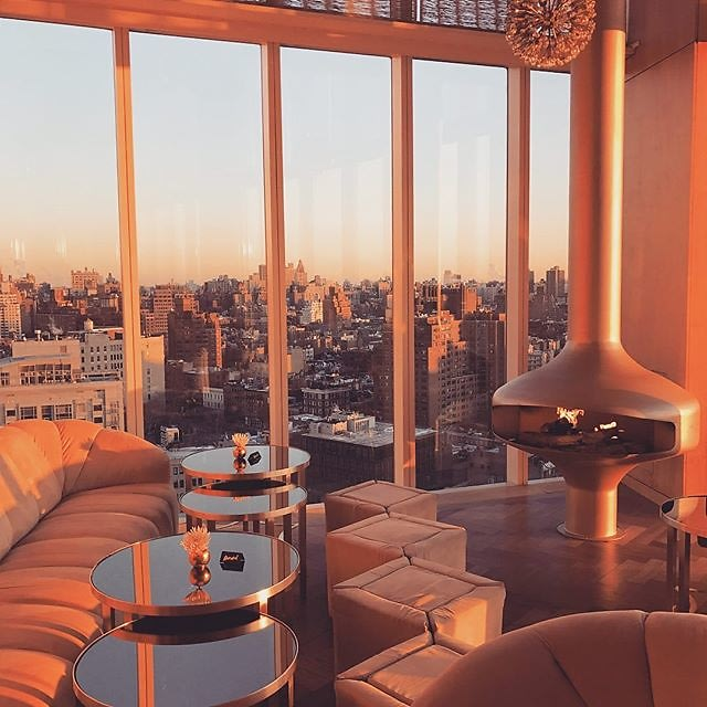 spectacular views of new york from plush chairs and table in NYC