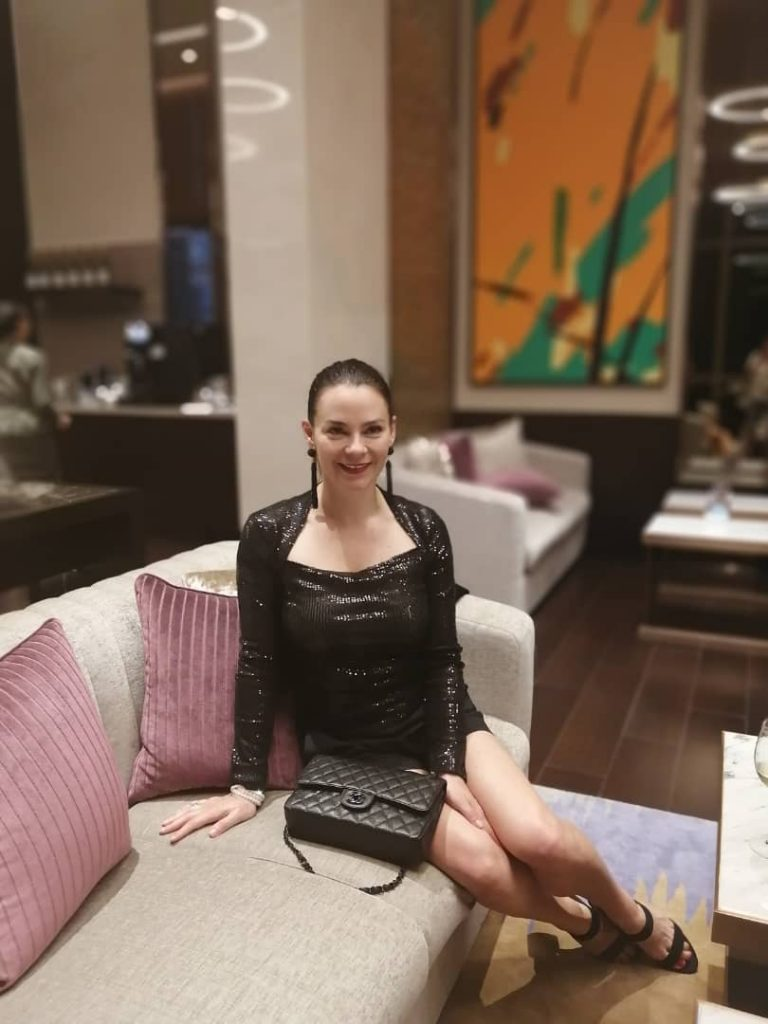 Brunette woman in sequin top in Kuala Lumpur.