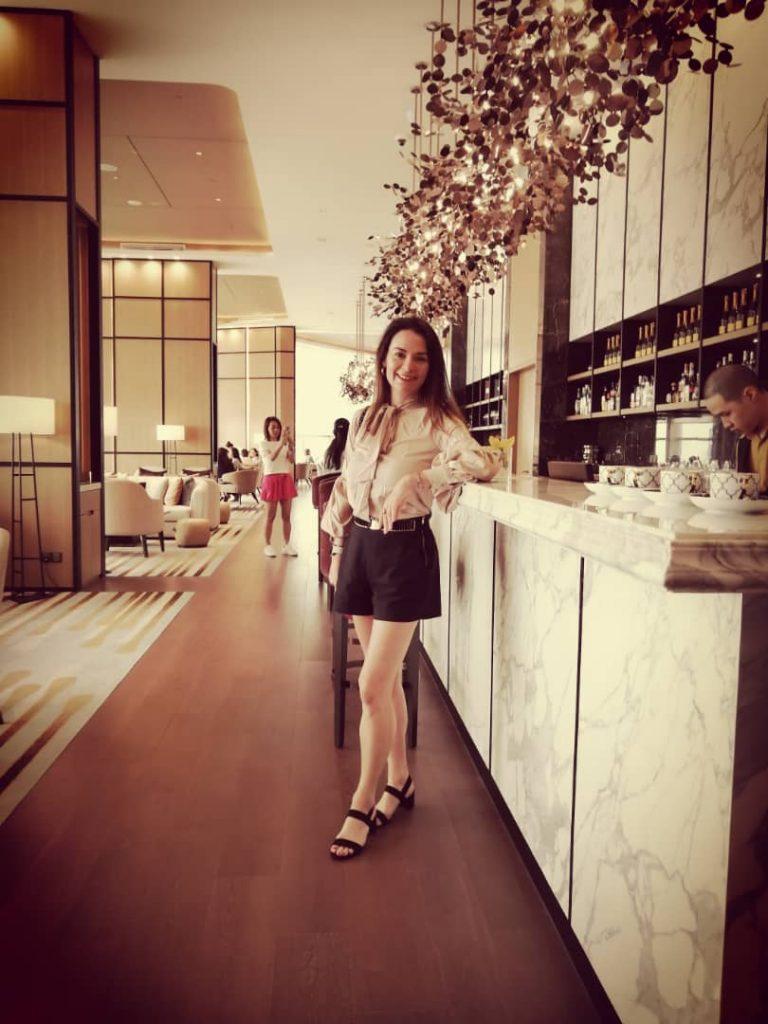 woman at long bar in Banyan Tree, Kuala Lumpur.