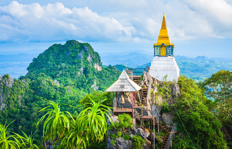 Thailand - image of spire though trees