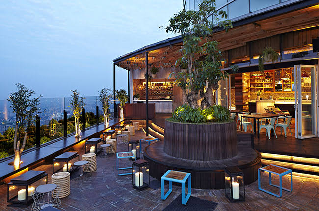 Rooftop Bar in Jakarta with timber floor and timber bar building