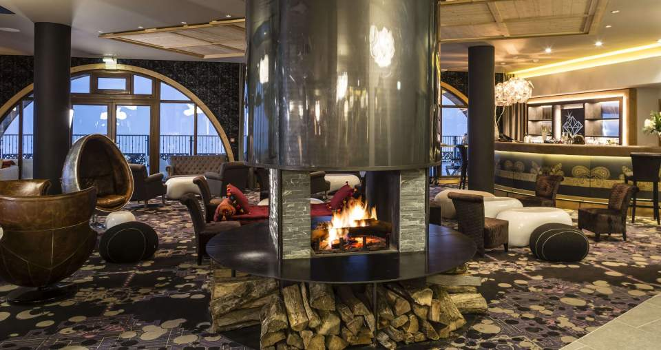 Fire place is upscale lobby of five star ski hotel in France