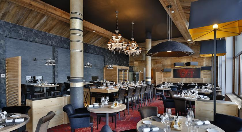 upscale dining room with red carpet and high wooden ceilings in the snow