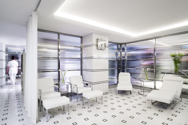 luxe white and black tiles with white furnture to lie on and white pillars