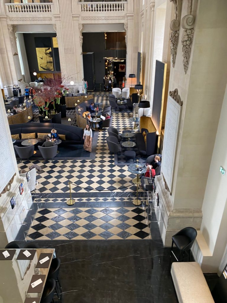 Looking down on black and white tiled floors in a five star hotel in france