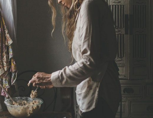 a woman cooking a Michelin star recipe at home