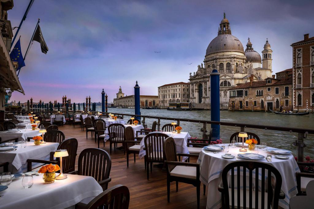 Beautiful tables overlooking a canal in venice