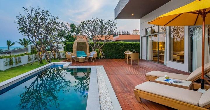 pool outside a villa at Avani Hotels