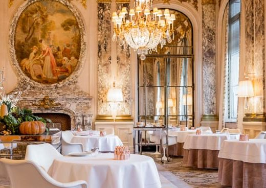 Luxe Parisian Restaurant with chandaliers and old world style huge windows and floors