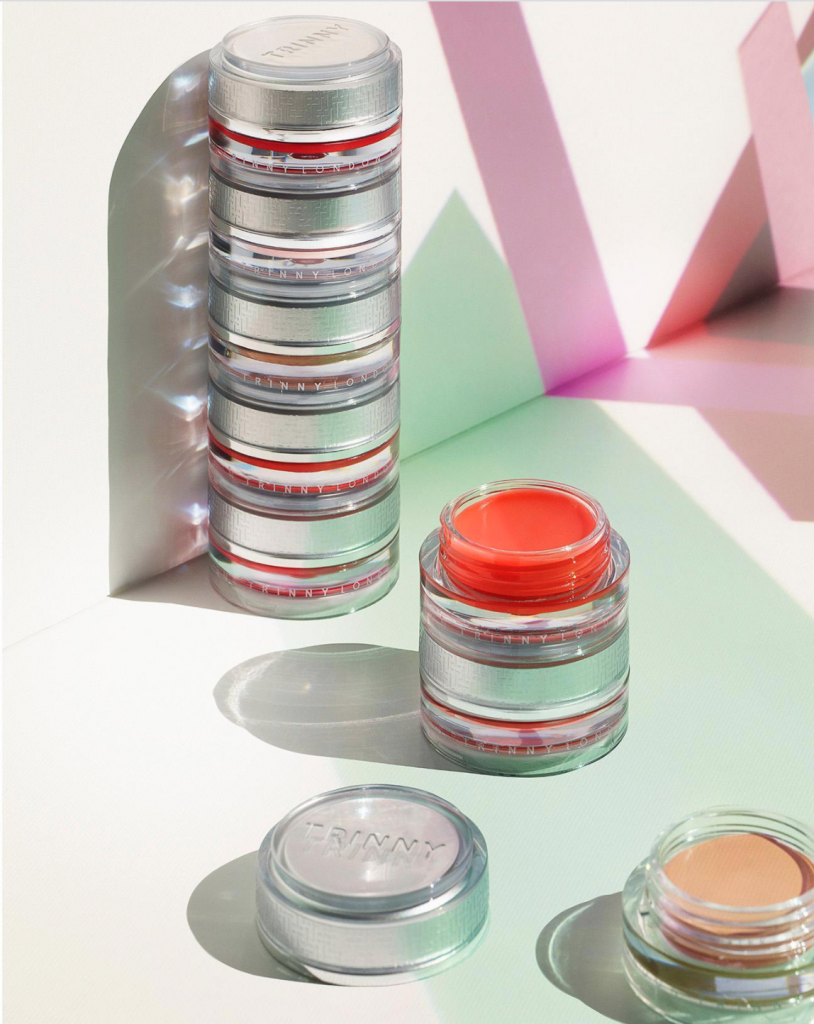 Trinny makeup product packaging stacked