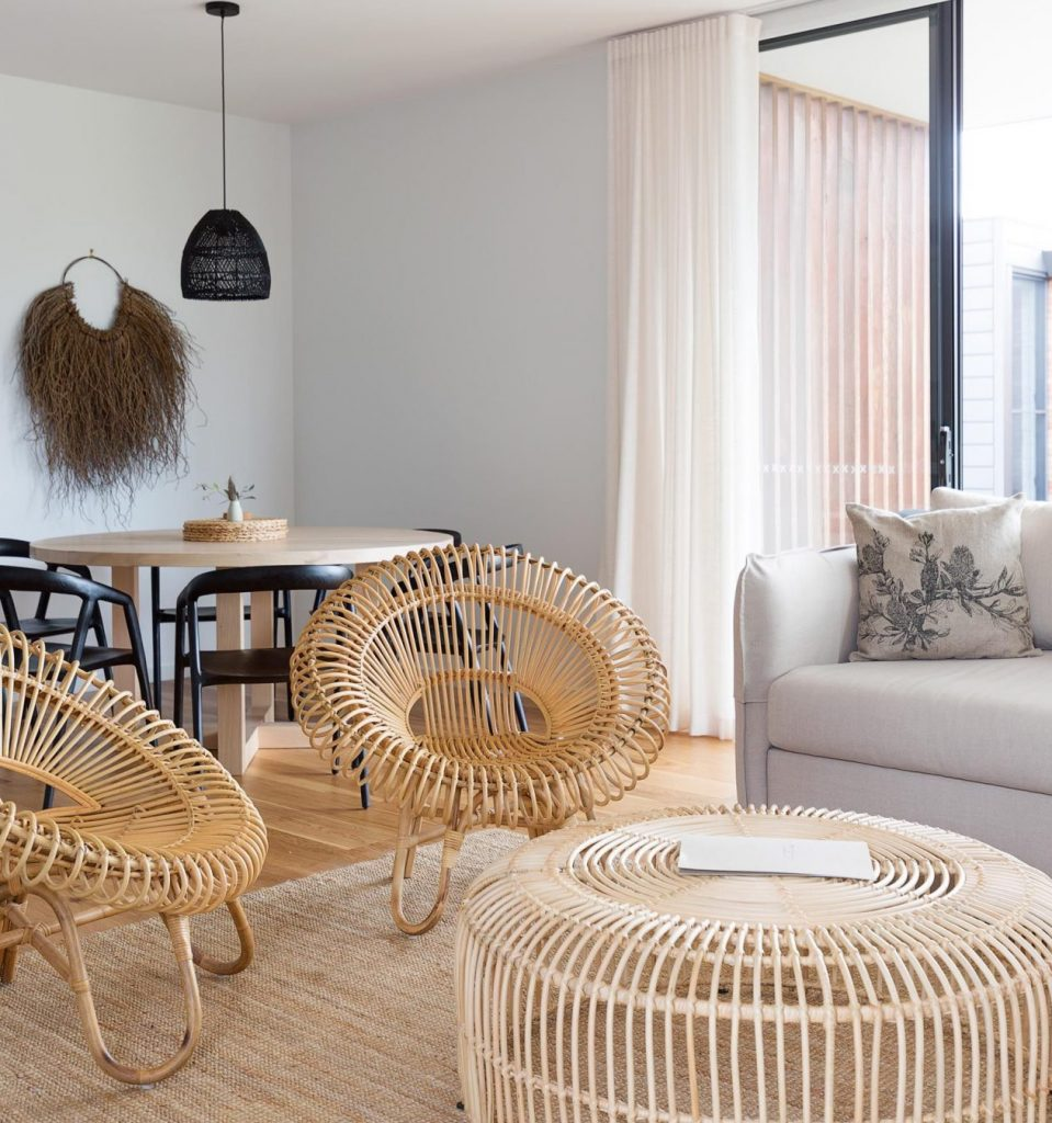 can chairs and white walls in the interiors of luxury villas