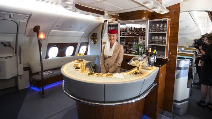 woman at bar onboard flight