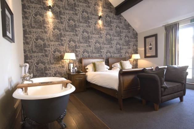 Luxury hotel rom with bath and wooden floors