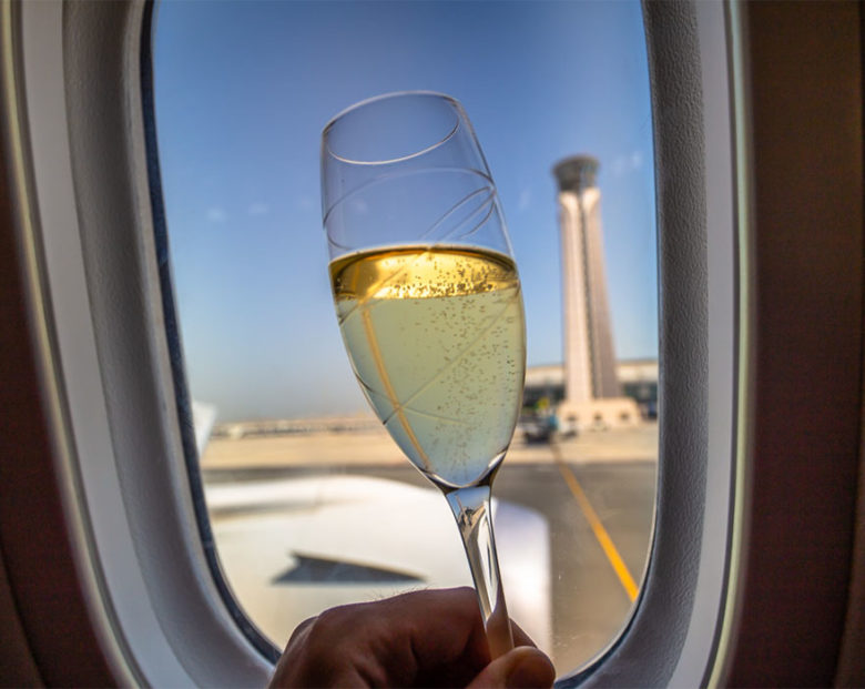 champagne glass in front of passenger window