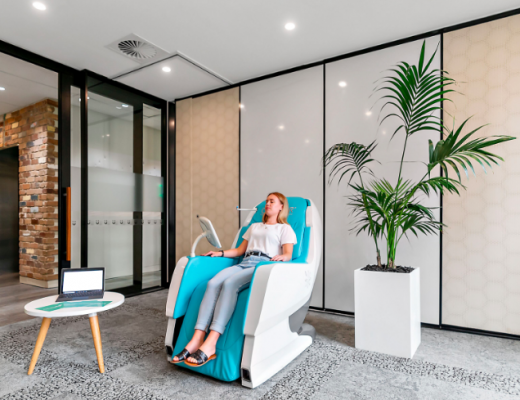 Wellness Solutions recovery room with a lady sitting in a wellness pod
