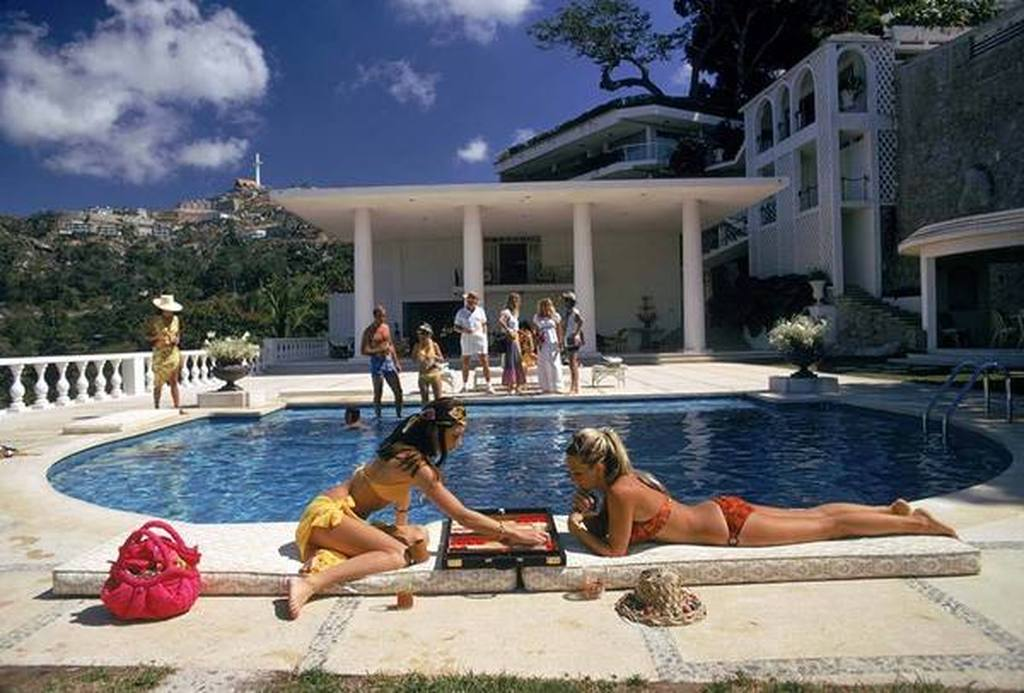Poolside BackGammon by Slim Aarons. Image from P'Inerest courtesy of Getty Images.