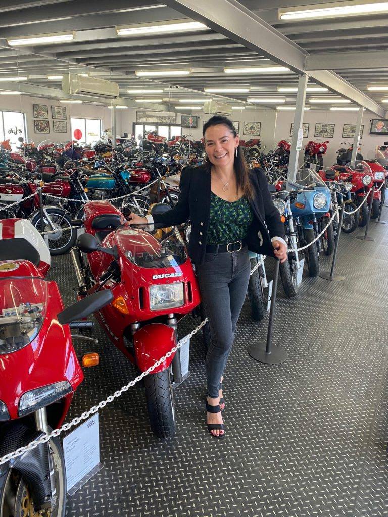 Renae at The Powerhouse Motorcycle Museum with a rotating collection of vintage and modern motorcycles.