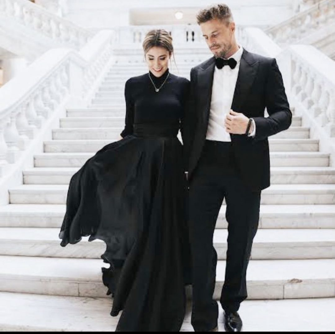 couple dressed up on stairs